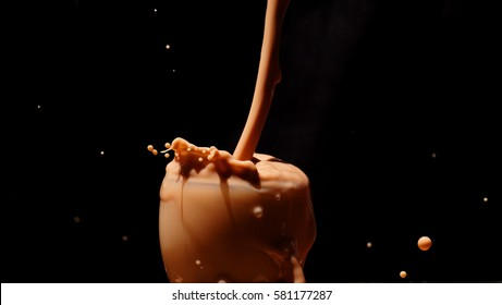 Chocolate splash / Chocolate milk is sweetened cocoa-flavored milk. It can be created by mixing chocolate syrup with milk