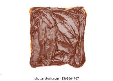 Chocolate spread on a slice of toast. isolated.