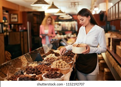 Chocolate Store. Woman Working In Chocolate Shop