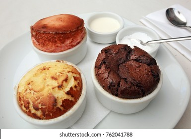 Chocolate, strawberry and coconut Souffles on the restaurant table