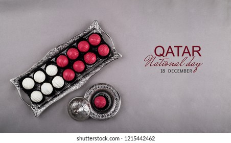 Chocolate sweets arranged like Qatar flag