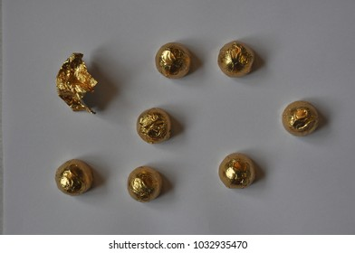 Chocolate sweets in a gold wrapper
