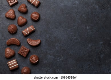 Chocolate sweets. Top view with space for your greetings