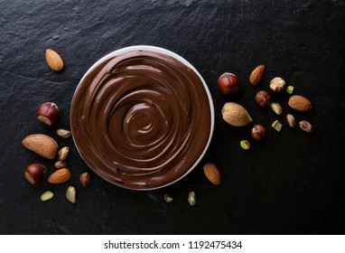 Chocolate swirl with mixed nuts in the background