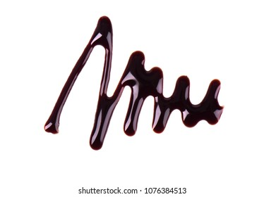 Chocolate syrup drop isolated on white background. Top view.