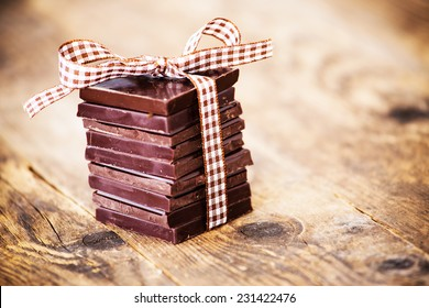 Chocolate tape connected to the wooden table.