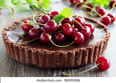 Chocolate tart with fresh cherry.