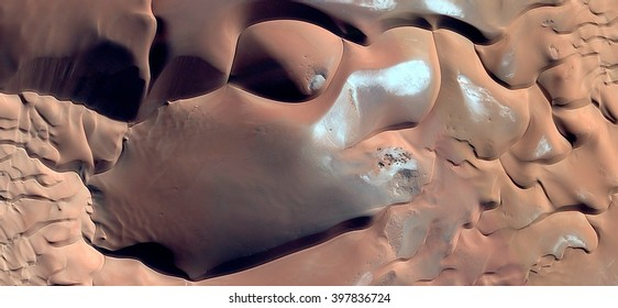 chocolate texture in Sahara dunes, abstract photography of the deserts of Africa from the air, bird's eye view, abstract expressionism, contemporary art, optical illusions,