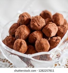 Chocolate truffle from chocolate, butter, honey, amaretto, cream, cacoa