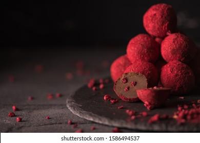 chocolate truffle with raspberry powder.dark mood photo