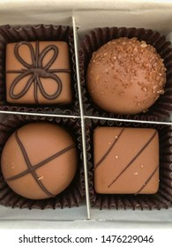 Chocolate truffle is a type of chocolate confectionery, traditionally made with a chocolate ganache centre coated in chocolate, cocoa powder or chopped toasted nuts (typically hazelnuts, almonds