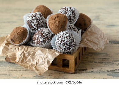 Chocolate truffles in cocoa and coconut chips, chocolate ganache with almonds, chocolate candies, handmade, Homemade sweets