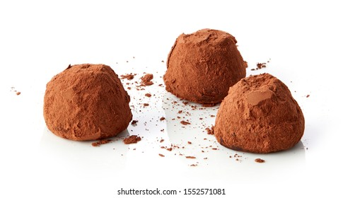 chocolate truffles covered with cocoa isolated on white background