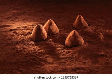 truffes de chocolat sur fond cacao en poudre