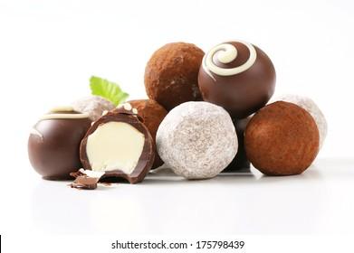 Chocolate truffles on white plate