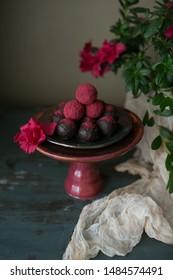chocolate truffles sweets with raspberry powder