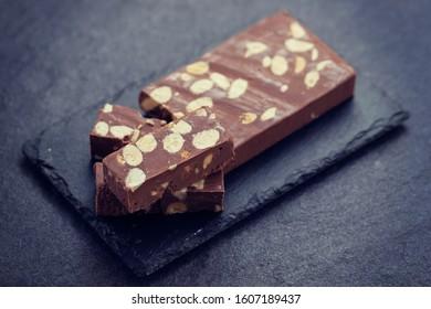 chocolate turron on ceramic background