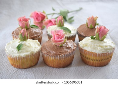 Chocolate and Vanilla Frosting Cupcakes decorated with pink fresh roses grouped together