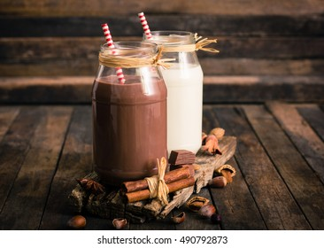 Chocolate and vanilla milkshake in the glass jar