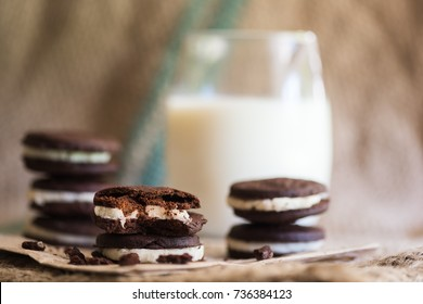 Chocolate wafer cookies with a glass of milk.