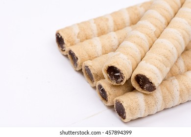 Chocolate wafer cream rolls isolated over white background