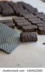 Chocolate, wafer sweets and black wafer sheet in chocolate production in Russia