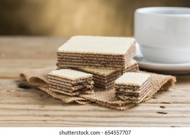 Chocolate wafers on chopping wood.
