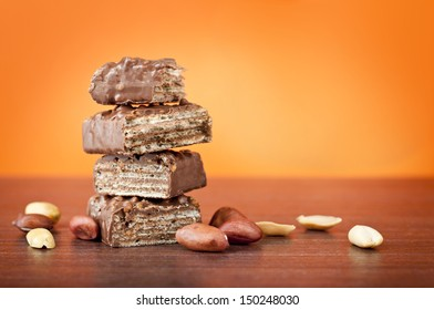Chocolate wafers with peanuts on table
