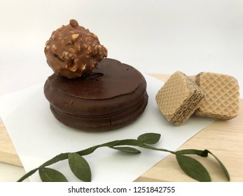 Chocolate waffles and sandwiche with antique wooden plate