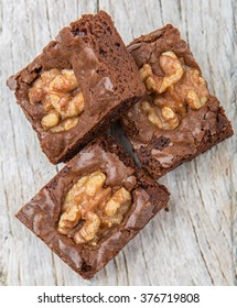 Chocolate walnut brownies over wooden background