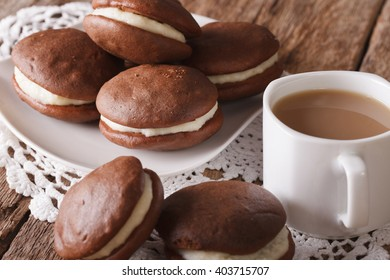 Chocolate Whoopie pie and coffee with milk close-up on the table. horizontal