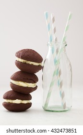 Chocolate whoopie pies with buttercream filling piled up