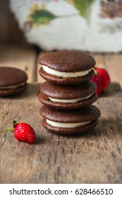 Chocolate whoopie pies with vanilla cream cheese and strawberry jam
