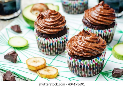 Chocolate zucchini banana cupcakes with chocolate avocado banana peanut butter cream frosting. toning. selective focus