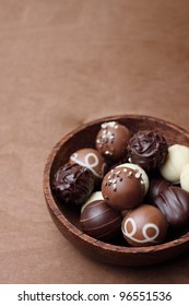 chocolates in a bowl of wood