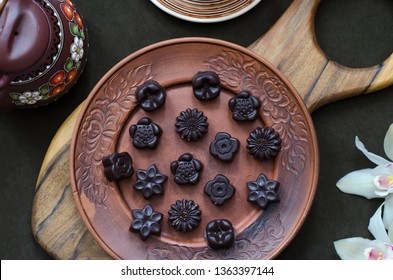 Chocolates with dried fruit nuts and sesame seeds