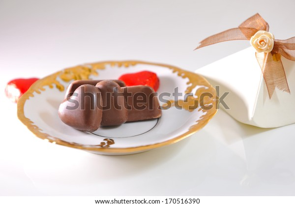 Chocolates on the golden saucer.