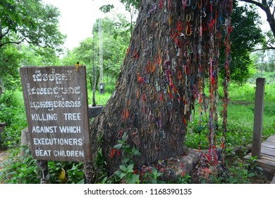 CHOEUNG EK KILLING FIELD, PHNOM PENH, CAMBODIA - JUN 25TH, 2018: Tree where the children were killed in Choeung Ek Killing Field, Cambodia, on Jun 25th, 2018
