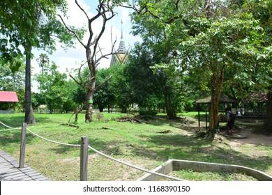 CHOEUNG EK KILLING FIELD, PHNOM PENH, CAMBODIA - JUN 25TH, 2018: Ordinary graves at the Choeung Ek Killing Field, Cambodia, on Jun 25th, 2018