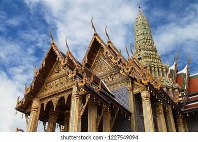 Chofa and Prang of the Royal Pantheon at Wat Phra Kaew, Bangkok, Thailand.