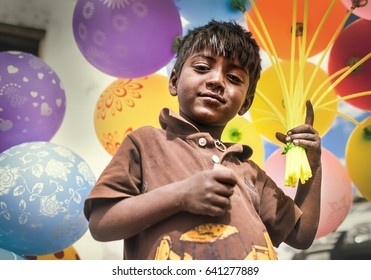 Choglamsar, Ladakh region, India – August 19, 2016: Little indian boy sells the ballons on AUGUST 19, 2016 in Choglamsar, Leh region, Jammu & Kashmir, India.