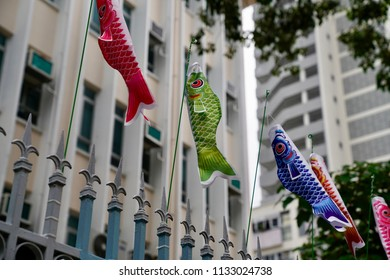 "Choi Hung, Kowloon, Hong Kong - 7 July 2018: Some ""Koinobori"" flags, meaning ""carp streamer"" in Japanese, are carp-shaped windsocks traditionally flown in Japan to celebrate month of May."