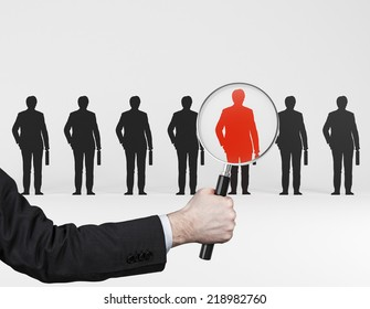 The choice of the best suited employee. Red human sign as a symbol of chosen one by the recruiter. HR, HRM, HRD ,CRM concepts.