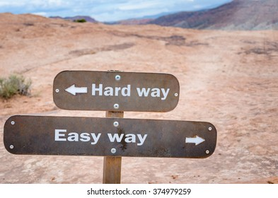 Choice between Easy and Hard Way. Conceptual Sign in a Desert Landscape.