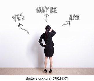 choice concept - Back view of business woman look white wall and think with yes or no choice