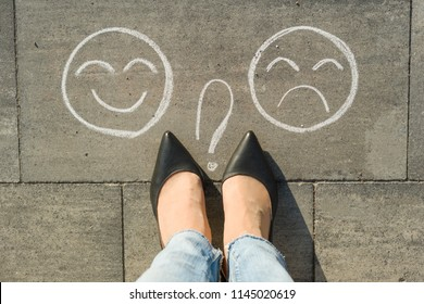 Choice - Happy Smileys or Unhappy, text on asphalt road.
