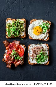 Choice of sandwiches for breakfast, snack, appetizers - avocado puree, fried egg, tomatoes, bacon, cream cheese, smoked mackerel grilled whole grain bread sandwiches. On a dark background, top view