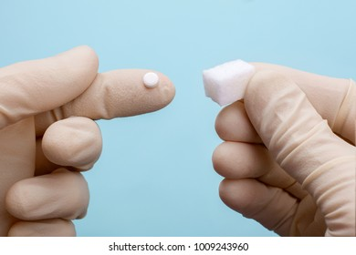Choice of Sweetener in tablets or regular sugar. Alternative to sugar for diabetics. Doctor or a scientist in gloves holds sugar in one hand in another sugar sauce in tablets.