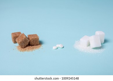 Choice of Sweetener in tablets or regular sugar. Alternative to sugar for people with diabetes. On a green background, brown and white in cubes and sugar substitute in tablets