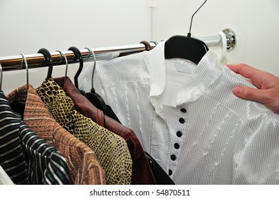 choice of a white blouse from a wardrobe